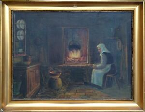 WOMAN BY FIREPLACE