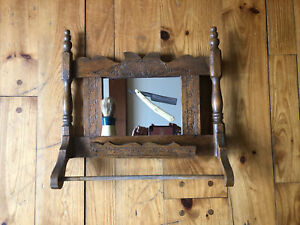 antique shaving mirror with brush and razor