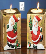 NEW~SET OF 2 SANTA CANDLE HOLDERS (CANDLES INCD.)