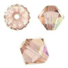 Genuine Swarovski Bicone. Light Peach AB Color. 4mm. Approx. 144 PCS. 5328