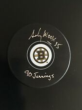 """ANDY MOOG AUTOGRAPHED BRUINS PUCK """"90 JENNINGS"""" J.S.A. AUTHENTICATED"""