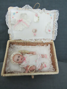 DARLING MAREE MASSEY JTD BISQUE BABY IN BASKET WITH LAYETTE