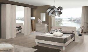 Camera matrimoniale moderna completa, armadio specchiato, letto, como', comodini
