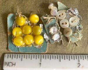 antique dimin. buttons store card remnants 9 white MOP,  8 yellow opaque glass