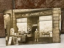 More details for antique real photo postcard of shopfront c.w.jones tobacco & toys