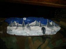 Bigfoot looking at moon snowy mountains painting driftwood bark