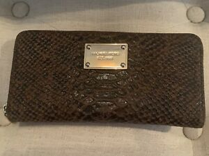 Michael Kors Zip Around Snakeskin style wallet. Brown. Gold Tone Hardware.