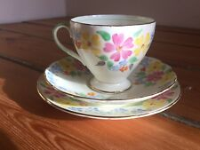 Vintage Foley floral teacup trio in pink, yellow and blue