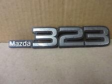 """Mazda 323 Emblem Ornament """" Mazda 323 """" Chrome"""