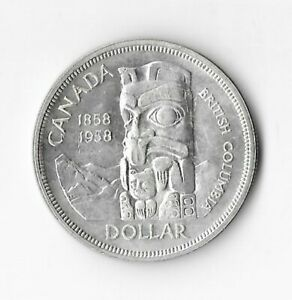 1958 Canadian Silver Dollar (luster)
