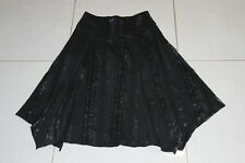 Womens size 6 asymmetrical black stretchy skirt made by JACQUI-E