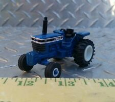 1/64 CUSTOM ERTL FARM TOY FORD 7710 OPEN STATION TRACTOR WITH STANDI RUBBER
