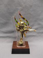 female Karate trophy award gold backdrop
