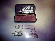 Greist Mfg. Co. sewing machine attachments in metal black box, vintage
