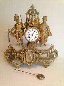 superbe horloge pendule de cheminée en régule doré par BRUNFAUT décor la chasse