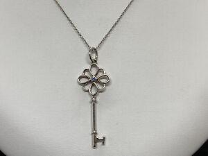 Tiffany & Co Sterling Silver Open Knot Key Pendant Montana Sapphire Necklace