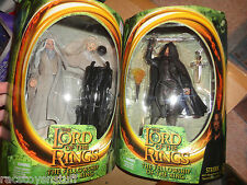 LORD OF THE RINGS ORIGINAL FELLOWSHIP FIGURES SARUMAN AND STRIDER, NEVER OPENED.