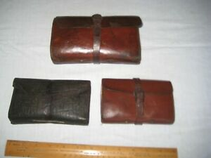 Vintage leather cast case/wallets x 3 unbranded with some contents