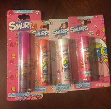 The Smurf's lot 3 lip balm and 1 gloss peach- strawberry- frosting new sealed
