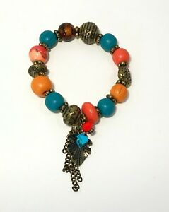 Colorful Stretch Bracelet With Wood Acylic And Brass Beads And Hanging Charms