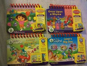 Lot of 4 My First LeapPad Game Cartridges And Books - Dora The Explorer, Leap