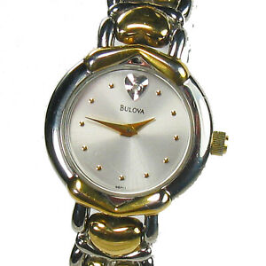 BULOVA women's watch - Light silver round dial with diamond  Gold hearts on band