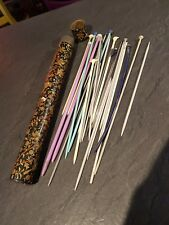 Antique ornate knitting needle holder and contents.