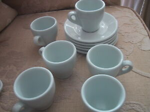 set of 4 heavy white expresso coffee cups and saucers