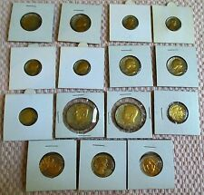LOT OF 15, TWO-TONED U.S. COINS WITH ACRYLIC COATING.
