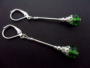 A PAIR OF DANGLY GREEN CRYSTAL BEAD  SILVER PLATED LEVERBACK HOOK EARRINGS.