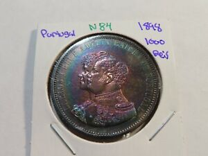 N84 Portugal 1898 Discovery of India 1000 Reis Rainbow Toning Obverse