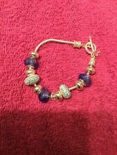 Silver charm bracelet with blue crystal beads