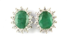 925 silver cluster stud earrings set with oval cut emeralds and cubic zirconia