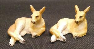 Two Miniature Sitting Red Kangaroos