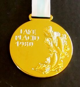 1980 LAKE PLACID WINTER OLYMPICS GOLD MEDAL WITH SILK RIBBON & STORAGE POUCH
