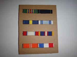 Group Of 8 US Military Ribbon Bars Mounted On 4 Metal Racks With Pinbacks