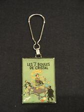 Hergé –  Tintin « Les 7 Boules de Cristal »  – porte clés Corner Coinderou