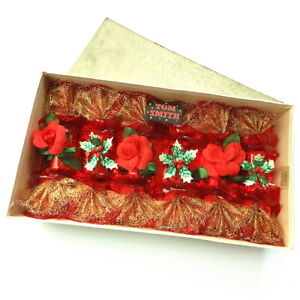 A FINE VINTAGE BOX OF TOM SMITH CHRISTMAS CRACKERS DECORATIONS