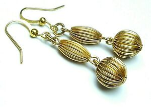 Vintage 1950s gold tone ribbed metal earrings to match 1950s necklaces