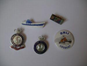 Vintage lifeboat badges