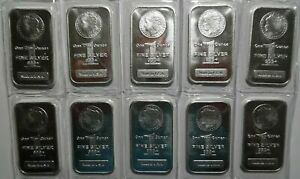 TEN ONE OUNCE MORGAN SILVER BARS ... MINT SEALED ... UNOPENED ...