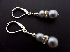 A PAIR DANGLY SILVER GREY GLASS PEARL  SILVER PLATED LEVERBACK HOOK EARRINGS.