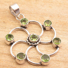 "Silver Plated Chakra Pendant 1.7"" 7 Natural Cut Green Peridot"