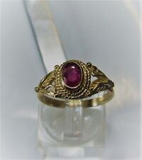 Natural ruby gemstone in a 9 carat yellow gold ring