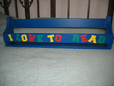 "WOOD WALL BOOK SHELF BLUE WITH LETTERING ""I LOVE TO READ"" ON FRONT 24""  New"