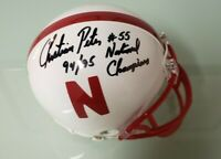 NEBRASKA FOOTBALL CHRISTIAN PETER #55 SIGNED MINI HELMET 94/95 NATIONAL CHAMPS