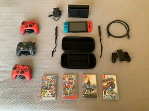 Nintendo Switch Neon Red/Blue Bundle (3 extra controllers, 4 games, case, +more)