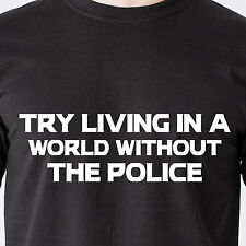 Try living in a world without the police. black lives jail cop gun Funny T-Shirt