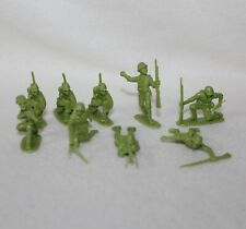 "Unmarked Set Of 9 ""MINIATURE PLASTIC LIGHT GREEN SOLDIERS"""