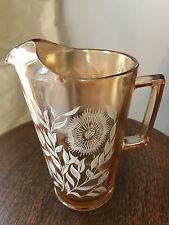 CARNIVAL GLASS PITCHER IN MARIGOLD WITH WHITE FLOWERS!!  BEAUTIFUL!!